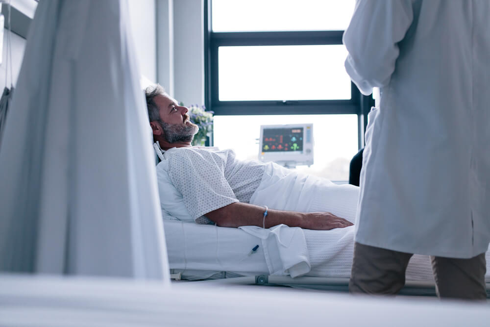 man in hospital with bowel cancer