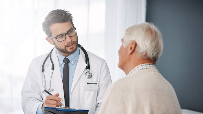 Doctor with male cancer patient