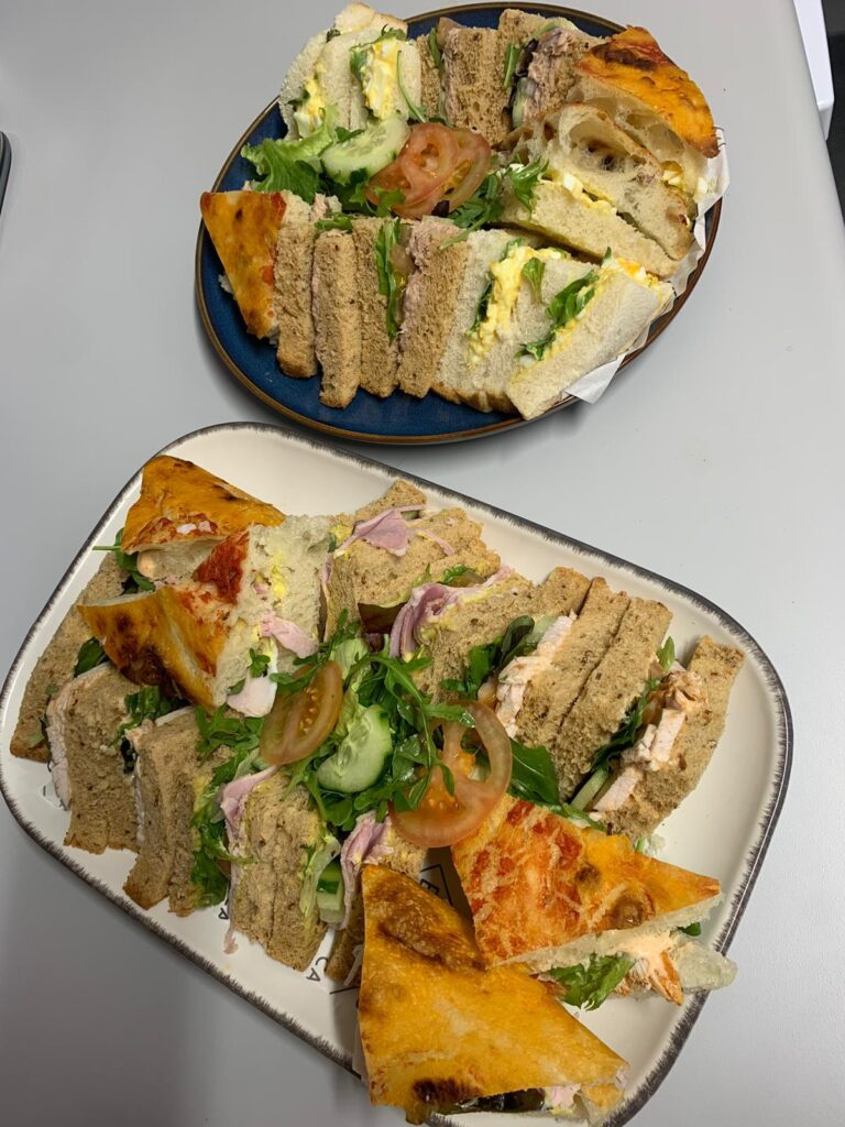 Colour photograph of two platters of sandwiches for afternoon tea at the Clatterbridge Private Clinic