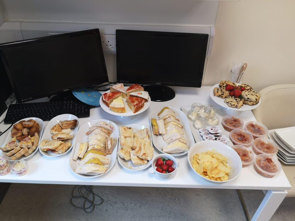 Colour photograph of afternoon tea at the Clatterbridge Private Clinic laid out on a white desk