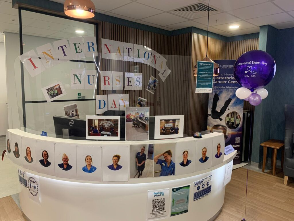 Colour photograph of the reception area at the Clatterbridge Private Clinic decorated with pictures of nursing staff, balloons and a banner for International Nurses Day 2021